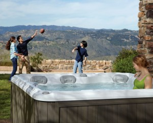 Playing football around a hot tub