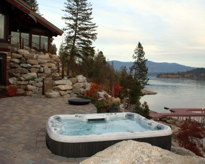 Outdoor hot tub installation in the fall by a lake.