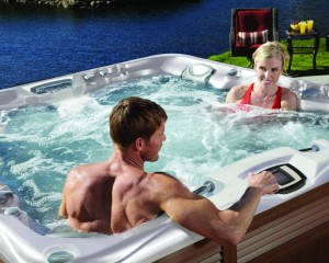 Two individuals sitting in a hot tub