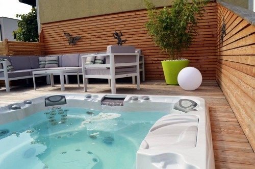 Outdoor hot tub installed into a deck.