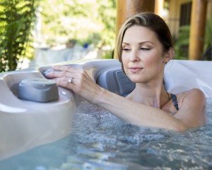 Woman about to practice yoga in her hot tub.