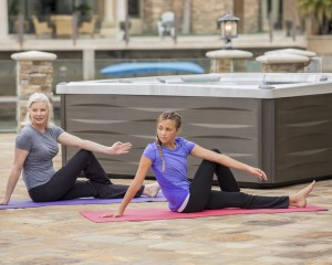 Yoga Stretching in front of Hot Tub