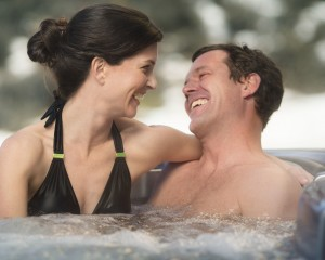Happy couple inside the hot tub.