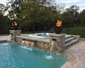 Outdoor hot tub installation and swimming pool combo with fire features
