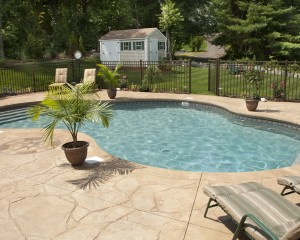 Backyard in-ground pool installation.