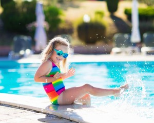 Little girl playing in the swimming pool.